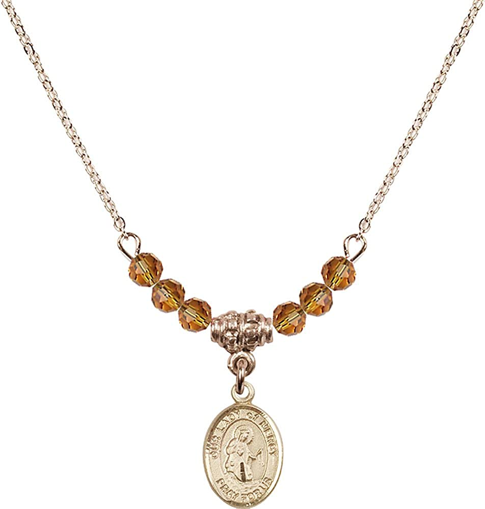 18-Inch Hamilton Gold Plated Necklace with 4mm Topaz Birthstone Beads and Gold Filled Our Lady of Mercy Charm.