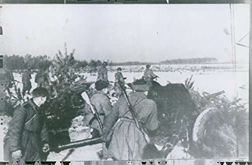 Vintage photo of Russian Armoured forces shoot farther and farther. ()