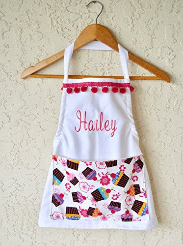 Girls personalized apron, cupcake pocket includes name sizes 18 months through Girls 10 - 12 Chef Hat option! from White Rabbit Custom