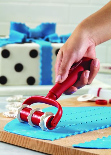 Plastic fondant ribbon cutter in red.
