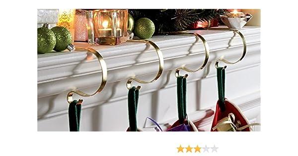 Ganchos para calcetines de Navidad, para la chimenea, con efecto de latón, conjunto de 4 piezas: Amazon.es: Hogar