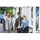 Haven Eric Balfour as Duke Crocker and Lucas Bryant as Nathan Wuornos Talking To Female Officer 8 x 10 inch photo