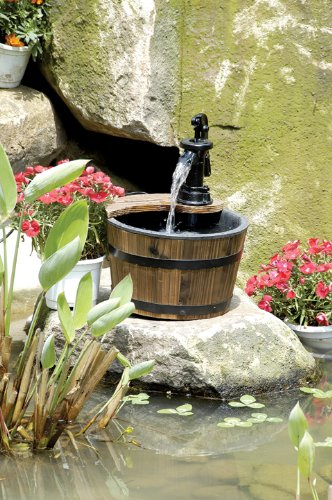 "Water Fountains Outdoor Wood Barrel with Pump - Small Garden Water Fountain Product SKU: PL50012 - You will delight in both the sight and gentle sounds of this hand-burnished water fountain! It was inspired by a laid-back country life, adding charm to any garden or patio. The design features a pump from which water trickles down into one large barrel. Simply plug it in and fill it with water. Display this wood barrel fountain as a garden ornament or outdoor sculpture. A great gift for gardeners. Product SKU: PL50012; Dimensions: 10.5"" W x 10.5"" D x 13.75"" H; Weight: Approximately 6 lbs; Use: Outdoor use in your garden or patio. Provides visual and auditory beauty for your yard and patio; Material: Solid fir; metal; Includes: UL listed submersible pump included; Other: Some assembly required. - patio, fountains, outdoor-decor - 51swo5NmuvL -"