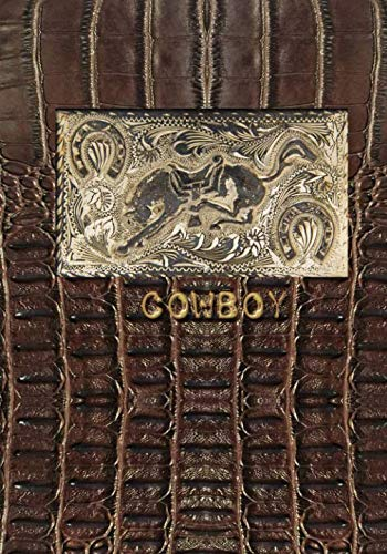 COWBOY: 7x10 lined notebook with antique horse belt buckle on brown leather background