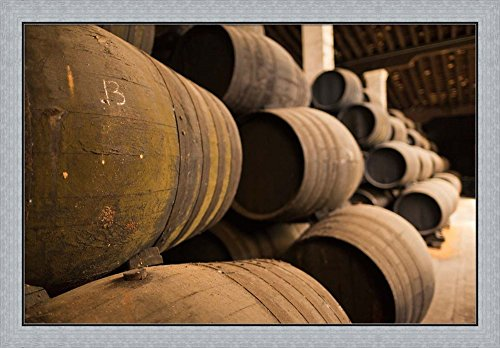 Sherry Casks, Bodegas Gonzalez Byass, Jerez de la Frontera, Spain by Walter Bibikow / Danita Delimont Framed Art Print Wall Picture, Flat Silver Frame, 41 x 28 inches by Great Art Now
