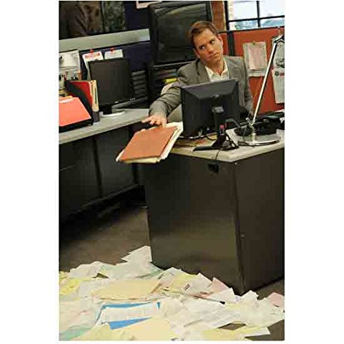 NCIS Michael Weatherly is Anthony DiNozzo Pushing Papers Off of Desk 8 x 10 Inch Photo ()