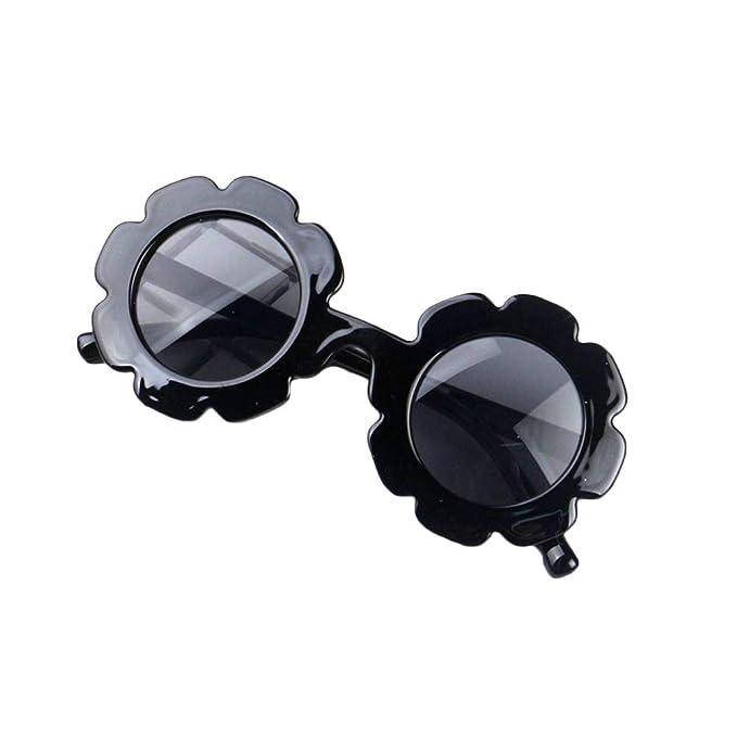 Amazon.com: Elegantes gafas de sol redondas con diseño de ...