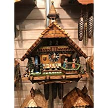 Cuckoo Clock Black forest house, turning mill-wheel with flowing water, turning dancers