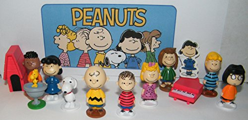 Peanuts Classic Characters Deluxe Party Favors Goody Bag Fillers Set of 13 with 12 figures and Special Decorative Figure with Charlie, Linus, Snoopy, his Dog House and More!]()