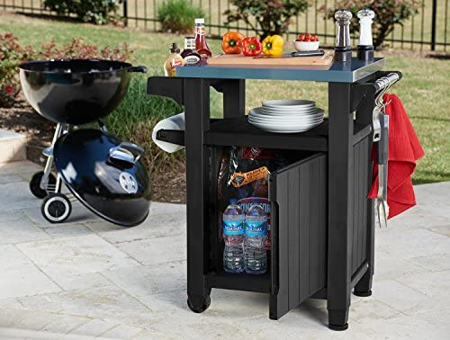 51tM9TpG RL. AC Keter Unity Portable Outdoor Table and Storage Cabinet with Hooks for Grill Accessories-Stainless Steel Top for Patio Kitchen Island or Bar Cart, Dark Grey    This plastic outdoor kitchen storage table with wheels combines two storage solutions in one, providing a stainless steel top for serving drinks or condiments and a cupboard for storing extra supplies. It works perfectly for a family barbecue or any friendly gatherings on the deck, giving you extra serving and storage space for plates, water bottles and more. Place snacks on the durable surface for friends to grab any time, and keep cloth napkins or grilling utensils hung easily within reach on the additional hooks.