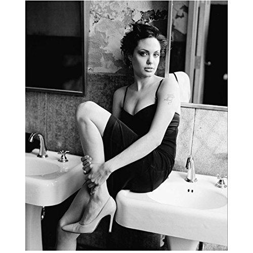 Angelina Jolie Short Hair Wearing Short Dark Dress Sitting On Sink in Bathroom One Knee Bent Up Black & White 8 X 10 Inch Photo