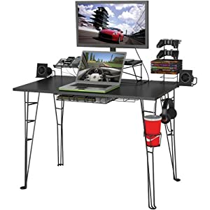 Tall standing desk with computer, monitor, and accessories