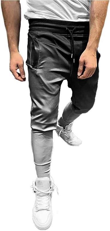 hombre con americana y pantalon de chandal