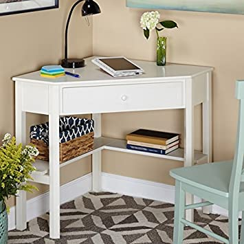 This Classically Styled Desk utilizes a Small Space for a Big Impact, with Stylish Under-Desk Shelving and a Drawer to Hide Clutter. Simple Living Wood Corner Computer Desk Antique White