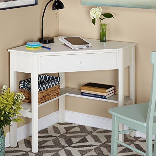 This classically styled desk utilizes a small space for a big impact, with stylish under-desk shelving and a drawer to hide clutter. Simple Living Wood Corner Computer Desk (Antique White) by Simple Living Products