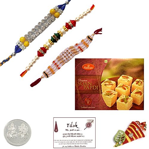 Bundle Set of 3 Multistone Rakhis with 250 grams Haldiram Soan Papadi and Laxmi Ganesh Coin - Exact Rakhi design will be (Bundle Set)