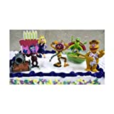 Adorable Disneys The Muppets 10 Piece Cake Topper Set Featuring Miss Piggy, Kermit The Frog, Animal, Fozzie Bear, Gonzo, Rizzo The Rat, Kermit's Row Boat, Gonzo's Cannon, A Decorative Cake, And Kermit's Rainbow Connection Decorative Cake Piece.