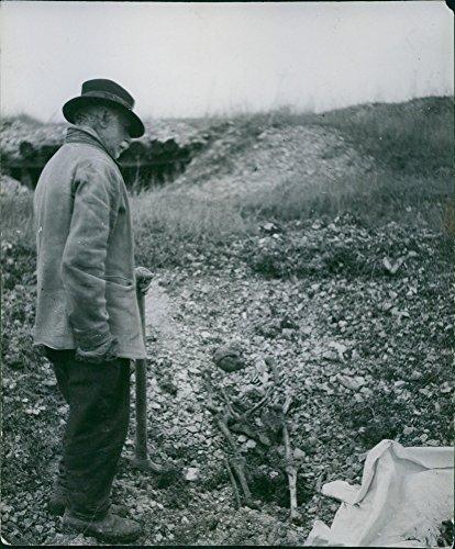 Skeleton In Ground (Vintage photo of Otto von Bismarck looking the human skeleton in the ground from World War)