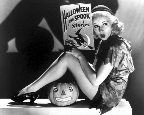 Betty Grable 16x20 Poster sexy leggy pose holding Halloween book]()