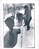 1969 Photo People Snow Covered Ground Metal Detector Shovel Workers Vintage