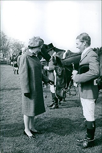 Vintage photo of Queen Elizabeth talking to a jockey.
