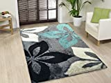 This rug features a polyester construction that provides comfort and durability. Beautiful colors and a plush pile height make this rug a great accent piece for any room.