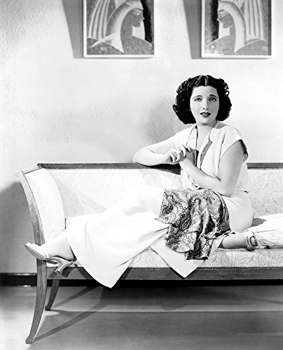 Posterazzi Kay Francis Modeling White Crepe Lounging Pajamas with A Paisley Sash Ca. Mid-1930S Photo Poster Print (16 x 20)