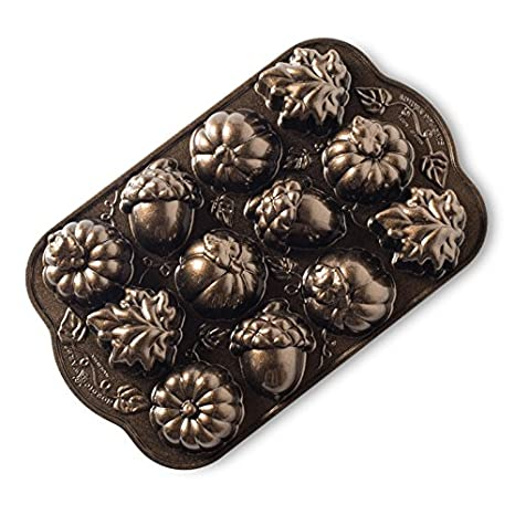 Amazon.com: Nordic Ware Autumn Delights Cakelette Pan: Kitchen ...