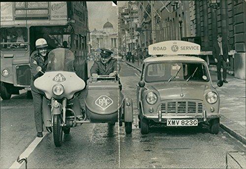 Vintage photo of Patrolman grahm harris pushing the last RAC motor cycle patrol combination.