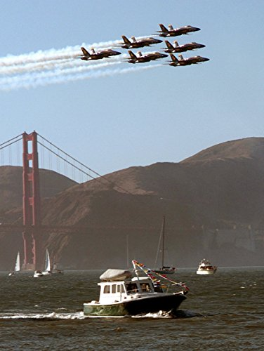 18a Blue Angels - U.S. Navy flight demonstration team, the Blue Angels, fly their F/A-18A Hornets past the Gold