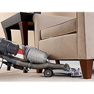 Hoover WindTunnel Air Bagless Upright Corded Lightweight Vacuum Cleaner - in use under chair