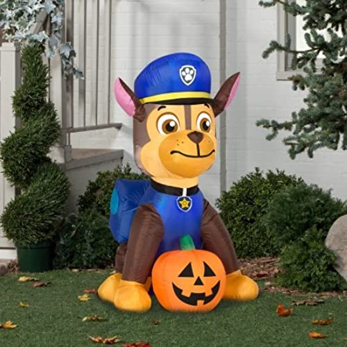 gemmy airblown inflatable chase from nick jr paw patrol sitting with a pumpkin holiday decoration 3 foot tall x 25 foot wide