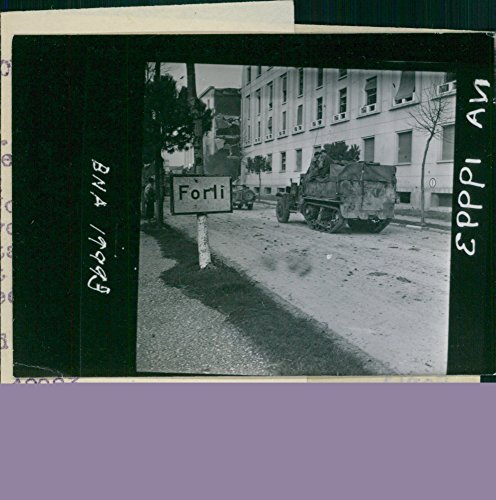 Vintage photo of Soldiers riding a tank entering Forli. 1944