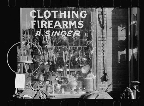 HistoricalFindings Photo: Secondhand Goods,Clothing,Firearms,A. Singer,Omaha,Nebraska,NE,FSA,Vachon]()