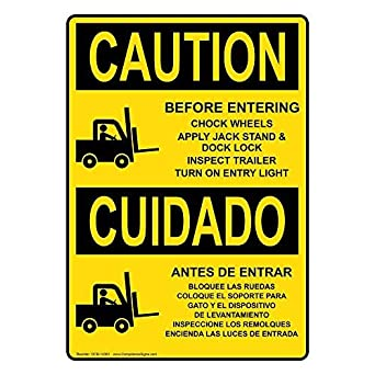 Vertical OSHA Caution Before Entering Chock Wheels Bilingual Sign with English + Spanish Text and Symbol