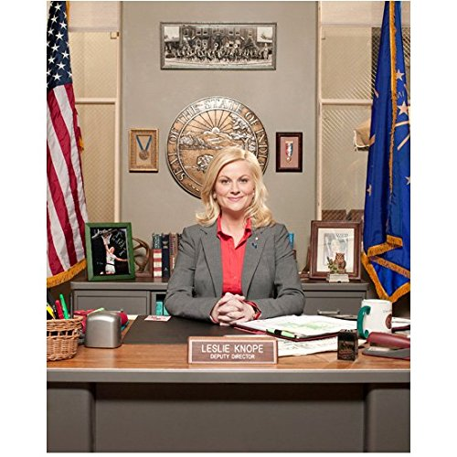 Parks and Recreation Amy Poehler as Leslie Knope, Deputy Director Seated at Desk 8 x 10 Inch Photo