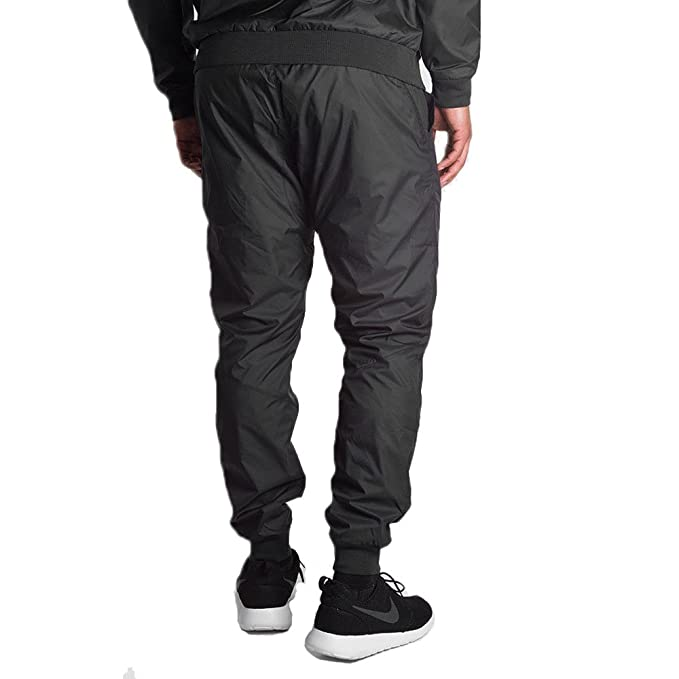 a07e3db570bad Nike Men's Windrunner Cuffed Track Pants Black 898403 010 at Amazon Men's  Clothing store: