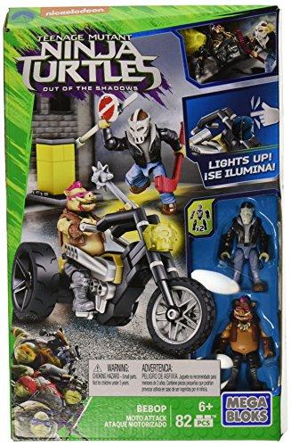 Mega Bloks Teenange Mutant Ninja Turtles: Out of The Shadows Bebop Moto Attack Playset]()
