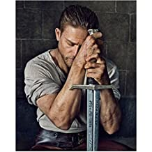 Charlie Hunnam 8 Inch x 10 Inch Photograph Pacific Rim Sons of Anarchy Children of Men King Arthur: Legend of the Sword Eyes Close Seated Leaning on Sword kn