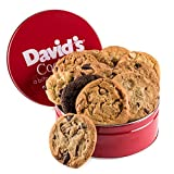 Make someone's day with this decadent gourmet cookie ensemble packaged in a vibrant red tin. Fresh-baked & shipped immediately!  Stuck on gift ideas? Surprise that special someone with the Fresh-Baked Cookies Gift Tin from David's Cookies...