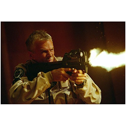 Richard Dean Anderson 8 inch by 10 inch PHOTOGRAPH Stargate SG-1 Stargate: Continuum Stargate: The Ark of Truth in Desert Camo Shooting Gun During Battle kn