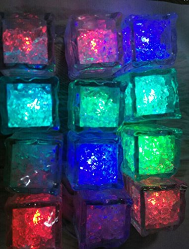Great Party Decoration or Unique Gift Decorative Party Xmas Pubs Bars Multi Colors UK 12 x Water Submersible Slow Flashing LED Ice Cubes with Flashing Multi-Color Lights Rocks