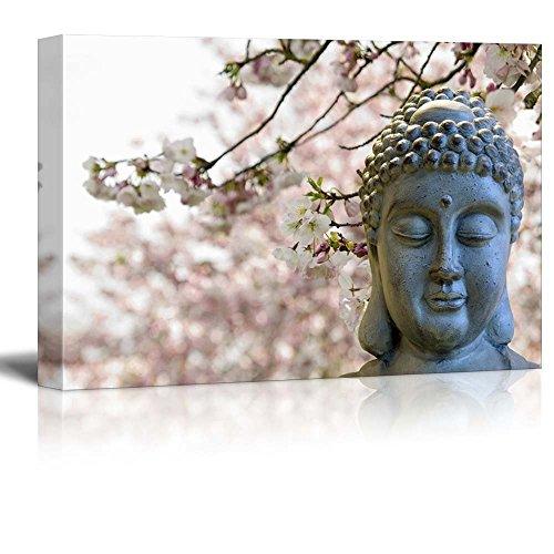 Buddha Statue on a Cherry Blossom Garden