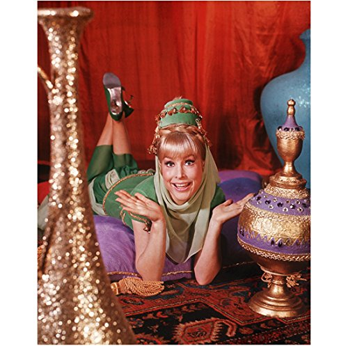 (Barbara Eden 8 Inch x10 Inch Photo I Dream of Jeannie 7 Faces of Dr. Lao Harper Valley P.T.A. Wearing Green Costume Lying Down Red Curtain in Background)