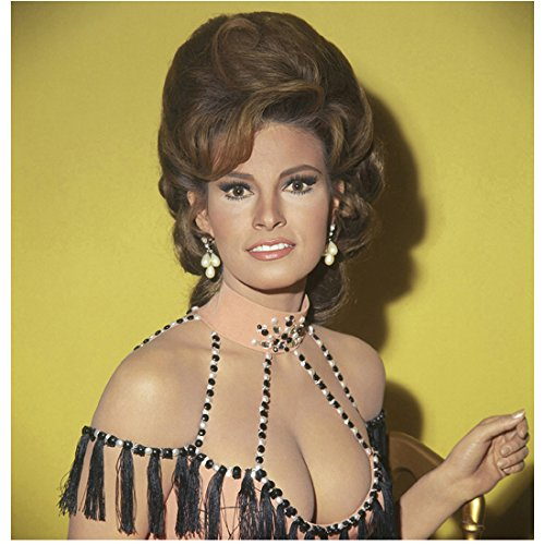 (Raquel Welch 8x10 Photo One Million Years B.C. The Three Musketeers Legally Blonde Beaded Straps, Fringes & Lots of Cleavage Yellow Background)