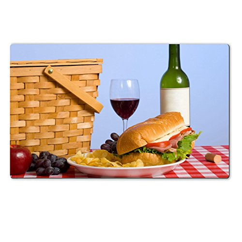Purple Grapes Picnic Baskets (Liili natural rubber Large Table Mat IMAGE ID: 3874956 A picnic lunch on a red and white gingham tablecloth including a sandwich chip grapes wine and a picnic basket in)