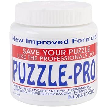 Amazon Com Ravensburger Puzzle Glue Amp Go 4 Oz Toys Amp Games