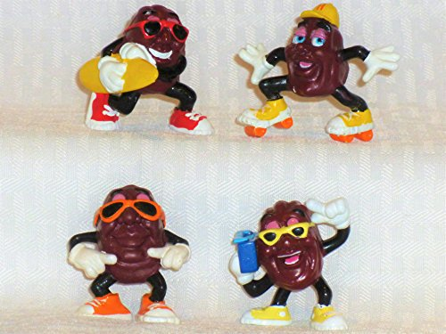 Four California Raisin Figures Having Fun at the Beach