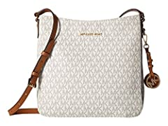 MK Signature PVC; lining: polyester Double handles with 9-in drop; adjustable strap with 20-22-in drop Top zip closure Exterior features silver-tone hardware, one pocket and logo medallion Interior features 3 open pockets and 1 cell phone poc...
