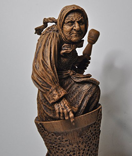 Baba Yaga the Russian Witch Sculpture]()
